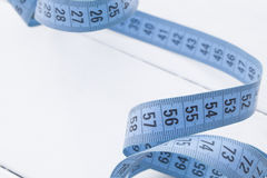 Measuring tape. Blue Stock Photography