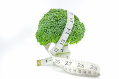 Measuring tape with broccoli. Stock Photo
