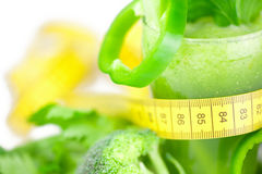 Measuring tape,broccoli,pepper,celery and celery juice Royalty Free Stock Photography