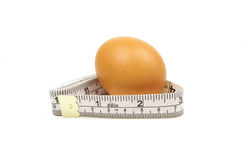 Measuring tape and brown egg Royalty Free Stock Photo
