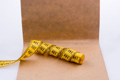 Measuring tape on brown paper Royalty Free Stock Images