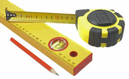 Measuring tape, building level and pencil Stock Photography