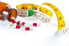 Measuring tape with capsule,  Dieting by medicine Stock Images