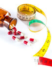 Measuring tape with capsule,  Dieting by medicine Stock Photos