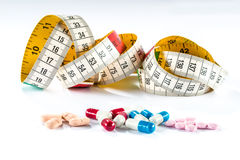 Measuring tape with capsule,  Dieting by medicine Stock Photo