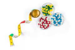 Measuring tape with capsule, Dieting by medicine Royalty Free Stock Photography