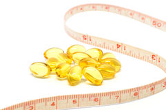 Measuring tape and capsules for dieting concept Stock Photo