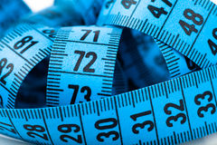 Measuring tape. Closeup view of tangled blue measuring tape Stock Photos