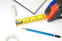 Measuring tape. Combined with office equipment Royalty Free Stock Images