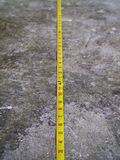Measuring Tape on Concrete Floo Stock Photography