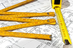 Measuring tape, construction drawings. Measuring tape end construction drawings Royalty Free Stock Images