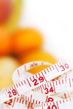 Measuring tape with different fruits Stock Image
