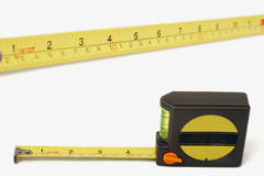 Measuring Tape Double Pack. Double pack containing close-up of a measuring tape and the full measuring tape unit. Two for the price of one royalty free stock photography
