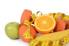 Measuring tape with dumbbells isolated Stock Photos