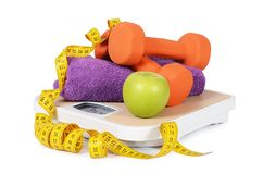 Measuring tape with dumbbells isolated Stock Photo