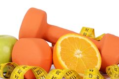 Measuring tape with dumbbells isolated Royalty Free Stock Photo