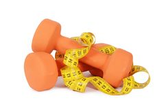 Measuring tape with dumbbells isolated Stock Photography