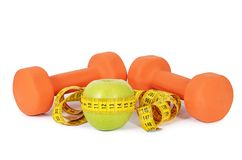 Measuring tape with dumbbells isolated Royalty Free Stock Photos