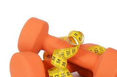 Measuring tape with dumbbells isolated Stock Images