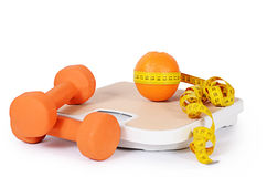 Measuring tape with dumbbells isolated Royalty Free Stock Image