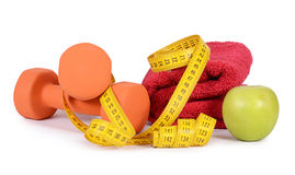 Measuring tape with dumbbells isolated Stock Image
