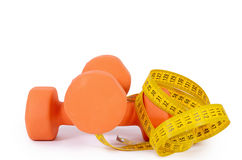 Measuring tape with dumbbells isolated Royalty Free Stock Photography