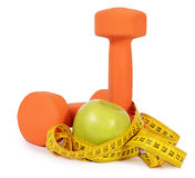 Measuring tape with dumbbells  Stock Image