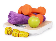 Measuring tape with dumbbells  Royalty Free Stock Images