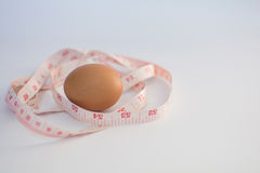 measuring tape and egg Royalty Free Stock Photo