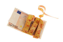 Measuring tape and euro banknotes Royalty Free Stock Photo