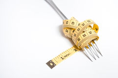 Measuring tape on a fork Royalty Free Stock Images