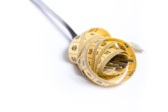 Measuring tape on a fork concept Stock Photography