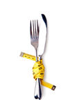 Measuring tape on a fork and knife Stock Photo