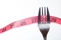 Measuring tape and fork Stock Photos