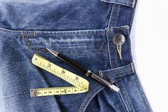 Measuring tape on front blue jeans Royalty Free Stock Images
