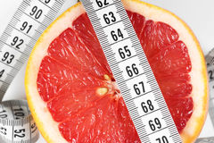 Measuring tape with grapefruit Stock Images