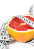 Measuring tape with grapefruit Stock Photography