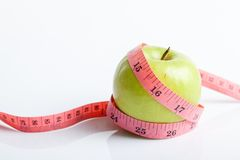 Measuring tape with green apple Royalty Free Stock Image