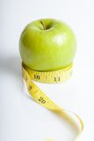 Measuring tape with green apple Stock Image