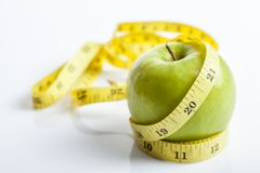 Measuring tape with green apple Stock Photo
