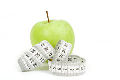 Measuring tape and green apples as a symbol of diet Stock Images