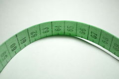 Measuring tape. Green Royalty Free Stock Images