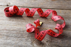 Measuring tape. On grey wooden background Stock Images