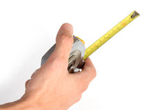 Measuring tape in hand Stock Images