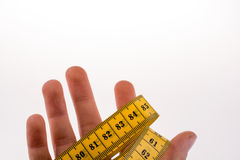 Measuring tape in hand Stock Photo
