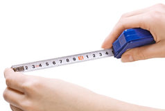 Measuring tape in the hands Stock Image