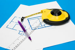 Measuring tape and house plan Stock Photos