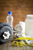Measuring tape and iron dumbbell Royalty Free Stock Photos