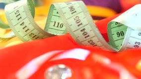 Measuring tape isolated on yellow and red clothes stock video footage
