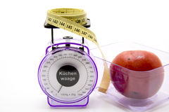 Measuring tape with kitchen scales Royalty Free Stock Images